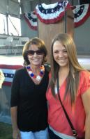 Sarah poses with another young supporter at Buckeye AZ event