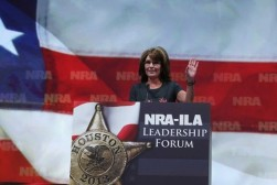 Sarah raises hand during her speech at 2013 NRA Convention in Houston TX