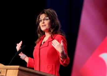 Sarah raises hands toward herself as she talks at SEU leadership forum