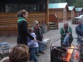 Sarah roasting hot dogs at Chilkoot Trail Outpost