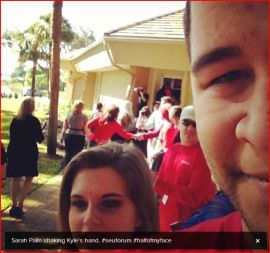 Sarah shaking hands outside at Southeastern University