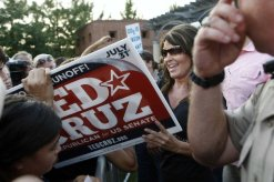Sarah signing back of Ted Cruz sign in The Woodlands