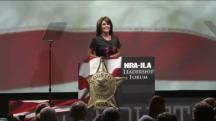 Sarah smiles at podium during 2013 NRA speech