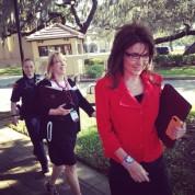 Sarah walking across campus at Southeastern University