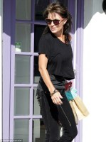 Side View of Sarah carrying shopping bags in Studio City CA