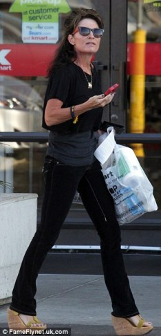 Side view of Sarah walking away from KMart in Studio City CA