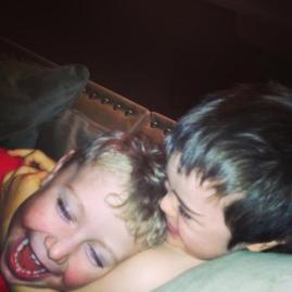 Trig and Tripp laughing on sofa