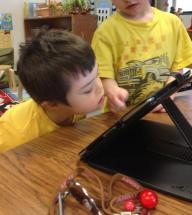 Trig at school looking at iPad
