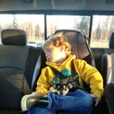Tripp asleep in back seat after first day at preschool