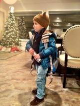 Tripp in outdoor gear with Christmas Tree in Background - December 2012