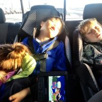 Tripp Trig and other child asleep in back seat